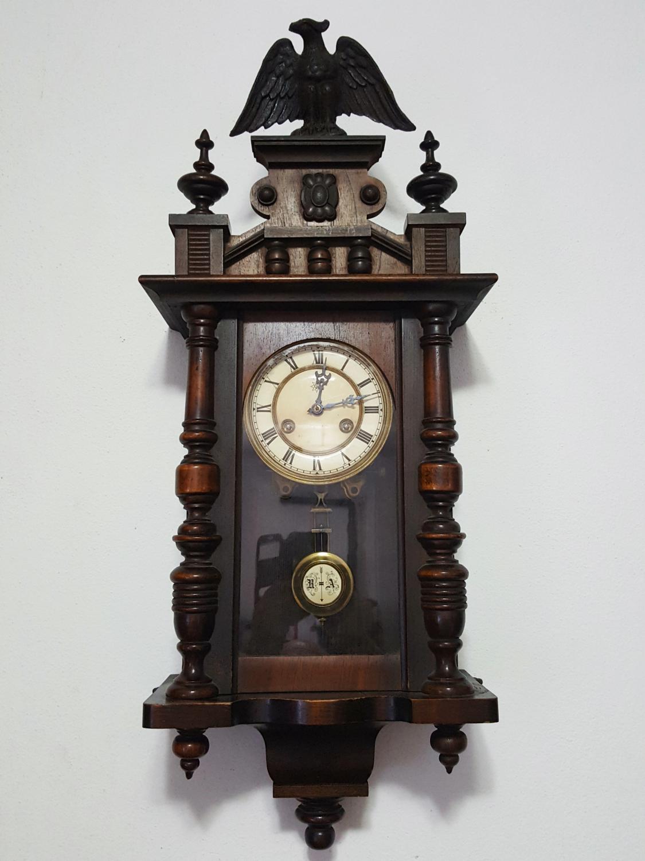 Antico orologio a pendolo Junghans con aquila Veroantico